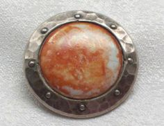 VINTAGE ARTS & CRAFTS HAND HAMMERED PEWTER RUSKIN POTTERY BROOCH. photograph by zebrafox.