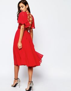 $66 Image 1 of ASOS Lace Up Back Caftan Sleeve Midi Dress