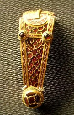 Sutton Hoo find, Anglo-Saxon slider. See how the tiny gridwork under the garnets pops out in the light!