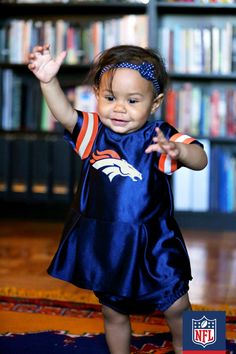 Touchdown Manning! Well, at least that's what she would say if she could talk. Look how cute this baby Broncos fan is!