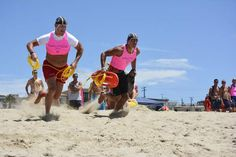Captain Kent Buckson of the Rehoboth Beach Patrol, left, and Ruslan Kopunek race to the water for the start of the Landline Rescue race. The team of Buckson, Kopunek, Matthew Keen and Annie Carter placed second overall. Click http://capegazette.villagesoup.com/p/local-lifeguards-represent-lower-delaware-in-california/1043205 to read lifeguard article: Local lifeguards represent lower Delaware in California by Lexi Coon