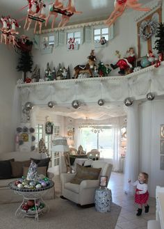 The Wilcock Family - what a wonderfully decorated room.  Love the santa and reindeers hanging from the ceiling.