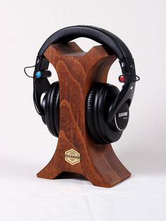 Welcome to the Rockwood - wooden accessories shop! - STARE-CON-  Headphones stand. Made of two parts of beech (a genus of deciduous trees in the family Fagaceae, native to temperate Europe, Asia and North America) and finished with premium Danish oil. There is a metal Rockwood logo shield in the center.  It is a beautifull addition for your headphones and interior! Great gift for and meloman