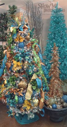 Christmas Tree -Christmas Tree Theme for 2014 #Peacock Christmas tree decorate in shades of #turquoise accented with #copper, #gold, and #green. This tree is rich in textures and finishes.