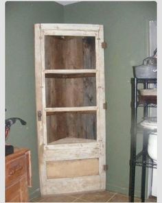 Old door into a corner shelf/cabinet