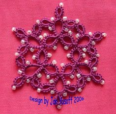 Tat-a-Renda Patterns: Rings only Snowflake with Beads. The pattern is here: http://tatsaway-patterns.blogspot.com/2008/08/rings-only-snowflake-with-beads.html#