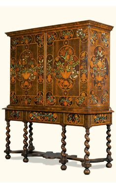 A William and Mary floral marquetry cabinet on stand late 17th c., possibly by Thomas Pistor; of walnut, olive oyster, stained fruitwood and ivory inlays, the front and sides elaborately decorated with flower vases and flowers, the two doors opening to reveal shelves and three further drawers, the stand with spirally twisted legs joined by a shaped marquetry stretcher 191cm. high, 163cm. wide, 59cm. deep; 6ft. 3in., 5ft. 4in., 1ft. 1 ¼in.
