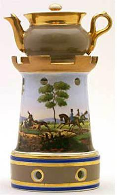 Trenton Teapot #390.     Cylindrical, greyish brown turret top stand, picture on stand three hunters, three dogs, a wild animal, trees, a house and river.     Acquired in Nice.