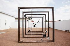"""a bio-acoustic sculpture by Roberto Pugliese, A Voice in the Desert. The piece was created for our exhibition """"Data Deluge,"""" curated by Rachel Gugelberger and Reynard Loki, and transforms Marfa's current weather conditions—temperature, humidity, wind speed, barometric pressure—into digital sounds within large steel frames."""