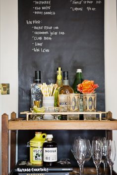 Bianca also used chalkboard paint and a stylish rolling cart to create a separate bar area—a decision that mitigates the dead space next to the cabinets and adds miles of style to the overall look of their kitchen.