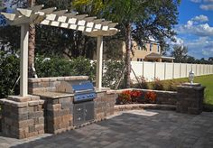 Keystone Country Manor wall blocks are the ideal choice for building an elegant outdoor kitchen as the centerpiece to your backyard.