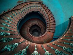 Love this spiral staircase in an abandoned home.