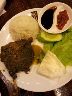 Nasi bebek. Spicy duck with rice. This super spicy food mostly found in Surabaya. One of the best Indonesian food.