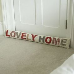 """Patchwork """"Lovely Home"""" Draft Excluder. My house is super drafty so I really like the idea of this, I think for mine, it'll say """"baby it's cold outside"""" . Door Draught Stopper, Draft Stopper, Door Stopper, Sewing Hacks, Sewing Crafts, Sewing Projects, Sewing To Sell, Machine Embroidery Projects, Idee Diy"""