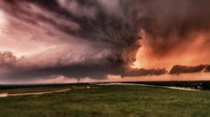 The Beast -- Supercell and Tornado    This photo was captured just west of Ada, Oklahoma on May 21, 2011 on an absolutely amazing storm chase day.By TornadoTitans