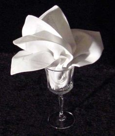The Lily Goblet Napkin Fold is perfect for the garden wedding or outdoor wedding.