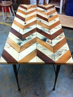 Gorgeous handcrafted table using reclaimed pieces, made by my future son-in-law !