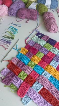 Very cute crochet pattern! Crochet several strips and then weave them together. I bet this pattern could be made into a crochet blanket!