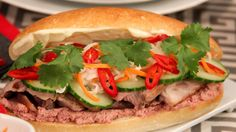 Pork Banh Mi | Steven and Chris | This French-Vietnamese hybrid by Chef Joshna is an example of all the best things a sandwich can be: full of flavour and texture, a balance of richness and sourness, and the perfect bun-to filling relationship. The little surprise explosions of...