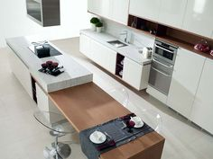 Modern Kitchen Interior Contemporary kitchen with combination island bench with stools in table setting - Modern-contemporary kitchen ideas Kitchen Island Bench, Modern Kitchen Island, Kitchen Dinning, Modern Kitchen Design, Home Decor Kitchen, Kitchen Interior, Home Kitchens, Kitchen Ideas, Dinning Table