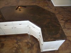 Acid stained concrete kitchen countertops, so much cheaper and original than granite.