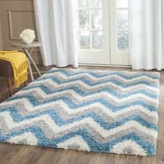 Found it at Wayfair - Kids Ivory & Blue Shag Area Rug