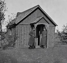 The Civil War through the lenses of Mathew Brady and Alexander Gardner Two Union Soldiers in heavy coats converse outside of the log hut, Virginia Peninsula, 1863. GETTY IMAGES