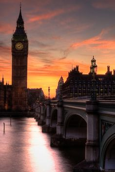 London, England... glowing Sunset,  Westminster Bridge and Parliament, with Big Ben, On the River Thames.