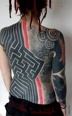 The tattooing style of Little Swastika is truly one-of-a-kind. #Inked #Inkedmag #tattoo #back #black #ink #art #pattern #design