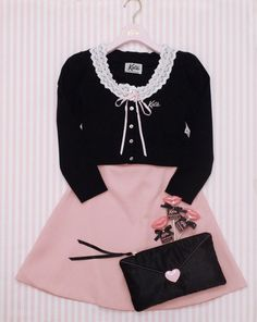 Super Kawaii fashion featuring a black heart purse, black top, with a pink skirt.