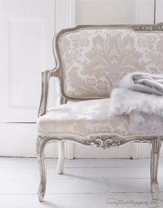 Antique silver and white damask-patterned love seat/chair. I would love just one gorgeous statement piece like this, probably in the bedroom.