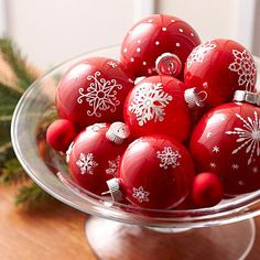 Single-Color Ornaments  Start with a collection of ball ornaments in a single color and embellish with white snowflake stickers. Red ornaments with white stickers look striking, but blue or green ornaments also would look spectacular.