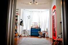 Cute boys room, love the punchy colors and high ceilings!