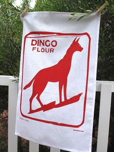 The Mokoh Design Dingo Dog teatowel is printed on super absorbant 100% cotton.    The iconic dingo dog flour sign on the historic and heritage listed building in North Frementle, Perth. The sign was painted over in the 2nd World War as it was seen as such a prominent landmark. Re-painted after World War 2 - Refugees and migrants coming to Fremantle saw the sign, and it remains a useful reference point for boaters and anglers.