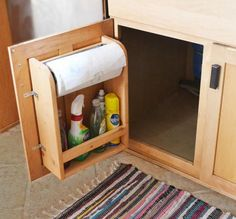Store your paper towels, cleaning supplies, and other camping items with a clever RV cabinet door storage unit design. Great addition to your RV...