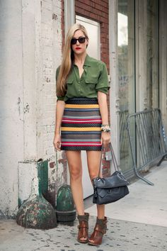 high-waisted pencil skirt with a silk blouse and military-inspired shoes