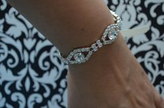 A small bracelet that matches headpiece style C041, Made of High Sparkle crystal rhinestones and a ribbon tie.