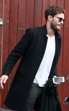One day after news broke of the casting, Dornan kept it cool with a blazer, white T-shirt and jeans.