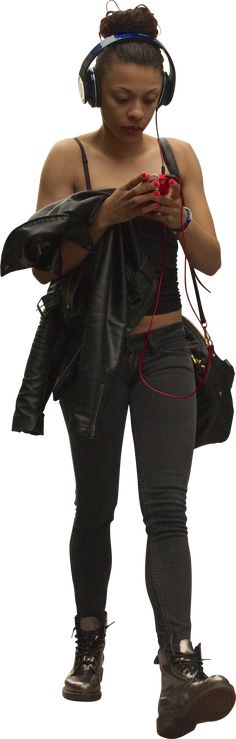 black woman using phone with headphones