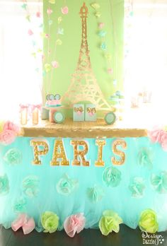 Paris in Springtime! Sharing details on how to create this party decor complete with the gold leaf Eiffel Tower tutorial. Plus you can win a trip to PARIS!! Free printables - Design Dazzle #MichaelsMakers