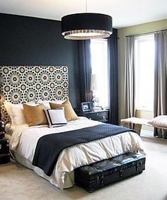 dark walls, light printed headboard.  Brings in accent colors.