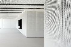 Image 25 of 44 from gallery of Headquarter building for the Science Park of the University of the Basque Country / ACXT. Photograph by Aitor Ortiz Cladding Panels, Wall Cladding, Space Interiors, Office Interiors, Architecture Metal, Perforated Metal Panel, Interior Cladding, Hotel Corridor, Facades