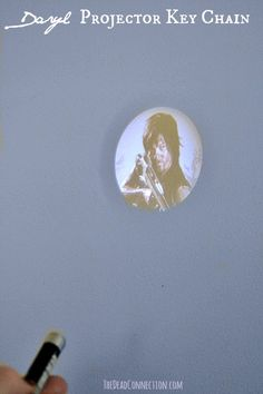 How cool is this Daryl Projector Key Chain. We picked this up at The Woodbury Shoppe! #TWD  http://www.thedeadconnection.com/look-inside-woodbury-shoppe-official-walking-dead-store/