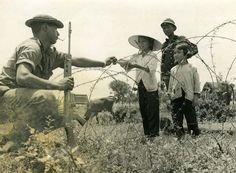 A soldier of the Royal New Zealand Infantry with some Vietnamese Locals 1969