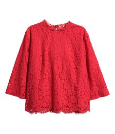 If your winter wardrobe is looking drearily full of knits and bulky pieces, try brightening it up with this lace blouse.