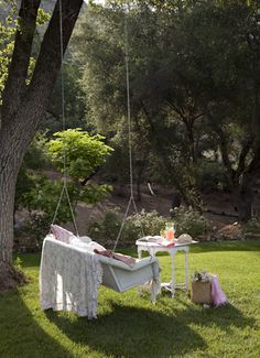 Swing and table in the yard. If only I had a tree such as this to make it possible. :)
