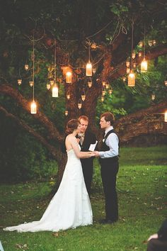 Hanging lanterns lit for ceremony decor and lighting.