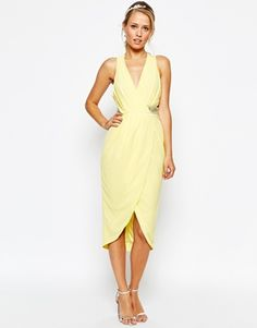 butter yellow spring wedding guest outfit idea
