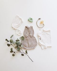 almost forgot to mention... we're having a girl! already working on her first outfit just need a tiny pair of mary janes for my springtime baby. romper by @misha_and_puff bonnet and onesie by @petitesoulshop @natursutten pacifier and a vintage rattle.