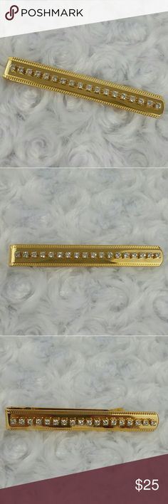 """VINTAGE Gold Tone Rhinestone Money Clip / Tie Clip This gold tone bar could be used as a tie clip of money clip. It has a row of prong set clear rhinestones set in perfect gold tone metal with etching along both sides. In like new condition,  it measures2 3/4"""" wide by 3/8"""" tall. Vintage Accessories Money Clips"""